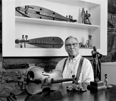 Tim Barnwell  -  Wade Martin, with wood carvings and fiddle, 2002 / Pigment Print  -  11x14 or 16x20