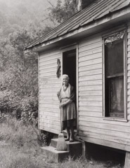 Tim Barnwell  -  Laura Cook Cleaning House, Gahagan Farm, Belva, Madison County, NC, 1981 / Silver Gelatin Print  -  11 x 14