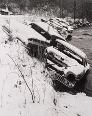 Tim Barnwell  -  Cars along creek bank, 1983 / Silver Gelatin Print  -  11 x 14