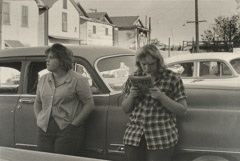 Ruth-Marion Baruch  -  Two Women Leaning Against Car, Walnut Grove, 1961 / Silver Gelatin Print  -  11 x 14