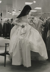 Ruth-Marion Baruch  -  Filipino Bride Choosing Wedding Dress From Rack of Clothes, 1961 / Silver Gelatin Print  -  11 x 14