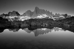 Peter Essick  -  Reflection of the Minarets in small pond near Cecile Lake. / Pigment Print  -  available in multiple sizes