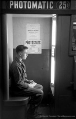 Harold Feinstein  -  GI in Photo Booth, Camp Kilmer, 1952 /   -