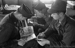 Harold Feinstein  -  Comic Books in Barracks, Ft Dix, 1952 /   -