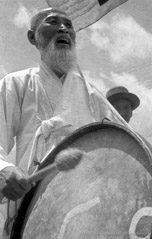 Harold Feinstein  -  Korean Drum Parade, 1953 /   -