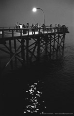 Harold Feinstein  -  Steeplechase Pier With Twilight Sparkles, 1974 / Silver Gelatin Print  -  available in multiple sizes