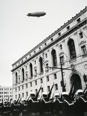 John Gutmann  -  Sailors in Parade with Navy Blimp. 1934 / Silver Gelatin Print  -  11x14