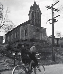 John Gutmann  -  Bicycling by the Old Village Church, Georgia, 1937 /   -  11 x 14