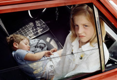 Vivian Maier  -  Chicagoland, 1978, (two kids red car) / Chromogenic Print  -  10 x 15 (on 16x20 paper)