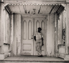 Arnold Newman  -  Man on Church Porch, West Palm Beach, 1941 / Silver Gelatin Print  -  11 x 14