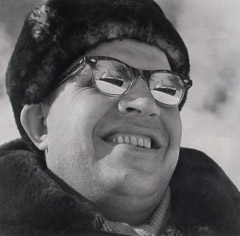 Yevgeny Khaldei  -  Smiling Man with Ships Reflected in Glasses, c.1950  / Silver Gelatin Print  -  13.75 x 14.25