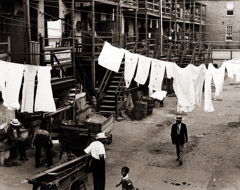 Peter Sekaer  -  Untitled (tenement street with laundry), c.1936 / Silver Gelatin Print  -  7 1/2 X 9 5/8