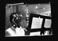 "Herb Snitzer  -  Sammy Davis Jr. singing ""No Greater Love"" with the Basie Band at a NYC recording studio, 1960 / Silver Gelatin Print  -  11 x 14"