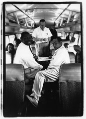 Herb Snitzer  -  On the Duke Ellington bus: saxophone players Cat Anderson (left) and Johnny Hodges (right) playing cards, NYC, 1961 / Silver Gelatin Print  -  11 x 14