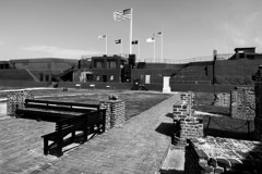 Tim Barnwell  -  2313, Fort Moultrie inside courtyard, benches left, flags top center, Charleston, SC /   -