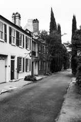 Tim Barnwell  -  2331, Houses & alley with tall fir trees near St. Michaels Church, Charleston, SC /   -