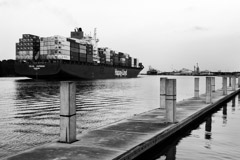 Tim Barnwell  -  2423, Cargo ship sailing out of Savannah River, GA-concrete pier foreground /   -