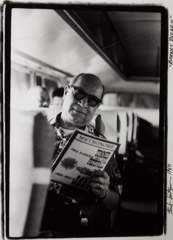 Herb Snitzer  -  Barney Bigard On Louis Armstrong's bus, reading Metronome Magazine, 1960 / Silver Gelatin Print  -  framed