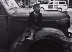 Ruth-Marion Baruch  -  Boy on Car, San Francisco, 1953 / Silver Gelatin Print  -  9 x 12
