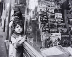 Jules Aarons  -  Paperbacks in the Window, West End, Boston / Silver Gelatin Print  -  9 x 11.5