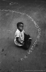 Harold Feinstein  -  Boy With Chalk Numbers, 1955 / Silver Gelatin Print  -  available in multiple sizes