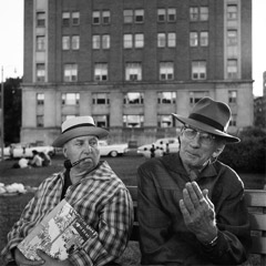 Vivian Maier  -  Untitled, no date, (2 men on bench) / Silver Gelatin Print  -  12 x 12 (on 16x20 paper)