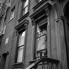 Vivian Maier  -  New York, NY, 1954 (cleaning window) / Silver Gelatin Print  -  12 x 12 (on 16x20 paper)