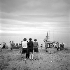 Vivian Maier  -  Untitled, no date (lake, boats sparkler) / Silver Gelatin Print  -  12 x 12 (on 16x20 paper)
