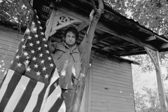 Al Clayton  -  Johnny Cash (flag/porch) / Pigment Print  -  Available in multiple sizes