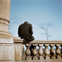Vivian Maier  -  Chicago, 1956 (man on stone rail) / Chromogenic Print  -  12 x 12 on 16 x20 paper