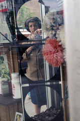 Vivian Maier  -  Self-portrait, Chicago, 1978 (3 circles) / Chromogenic Print  -  10 x 15 on 16 x20 paper