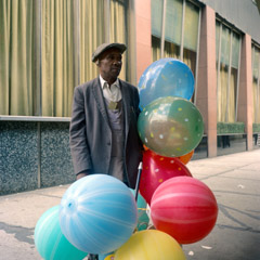 Vivian Maier  -  Chicago, 1971, (man & baloons) / Chromogenic Print  -  12 x 12 on 16 x20 paper