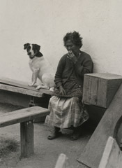 Ruth-Marion Baruch  -  Filipino Woman with Dog, 1961 / Silver Gelatin Print  -  9.5 x 6.5