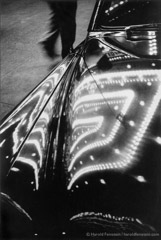 Harold Feinstein  -  CL-024 Times Square Lights Reflected on Car, 1953 /   -  Neg-042 NYC TimesSquare