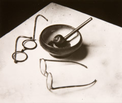 Andre Kertesz  -  Mondrian's Glasses and Pipe, 1926 / Silver Gelatin Print  -  3.25 x 3.75