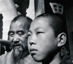 John Gutmann  -  Chief Monk and Novice of a Buddhist Temple. Yunnan