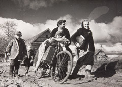V. Grebnev  -  Driver Georgi Iosigovich, His Wife and Children, returning to their home n the Kalinin  Region, 1944 / Silver Gelatin Print  -  5 x 7