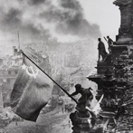 Yvegeny Khaldei, Raising the Hammer and Sickle over the Reichstag, 1945
